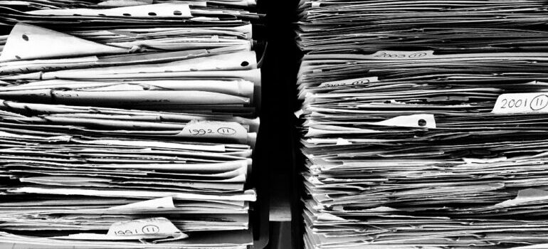 a stack of paperwork that you need to check before signing a moving contract
