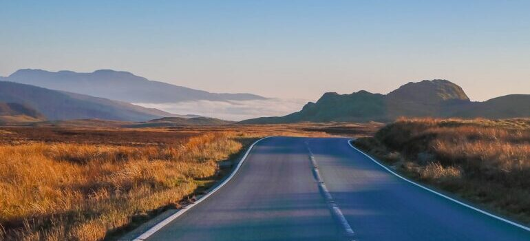 Open road with mountains in the background