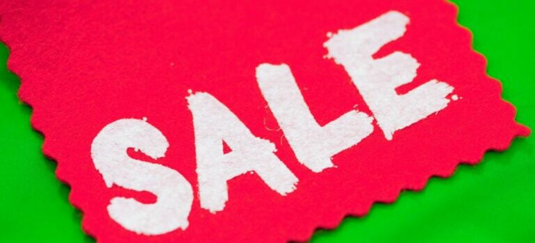 """""""sale"""" on the piece of cloth"""