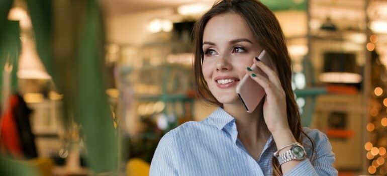 A woman making a phone call.